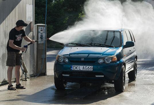washing vehicles with pressurized water